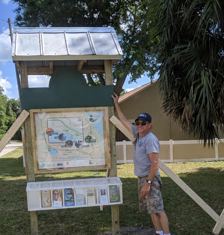 Bill Reagan of Reagan Custom Homes builds and erects the sign